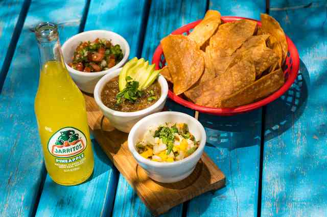 Jarritos Mexican soda with chips and dips