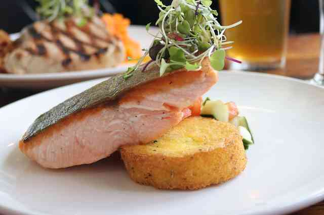 Pan seared salmon with polenta cake