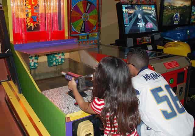 kids playing shooting games