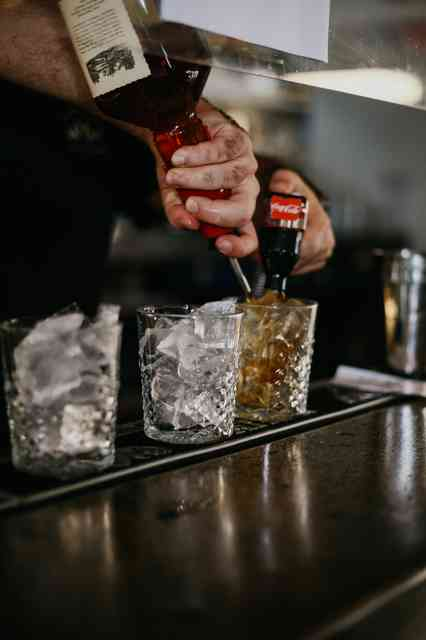 Bartender pouring drinks