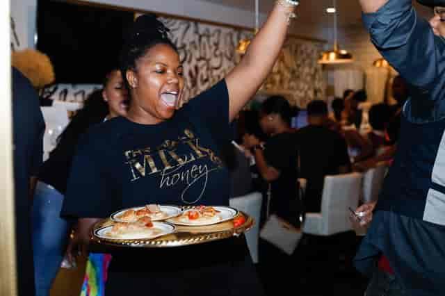 waitress holding food
