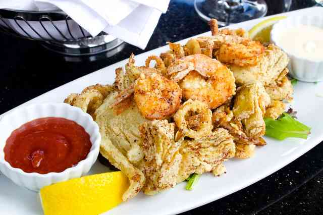 Frito Misto with calamari, shrimp, artichokes and fennel lightly fried. Served with lemon aiolo and cocktail sauce.