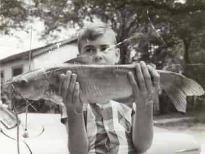 child holding fish