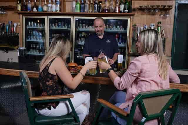 women seated at bar