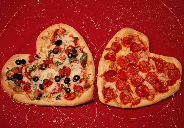 Two pizzas in the shape of a heart.