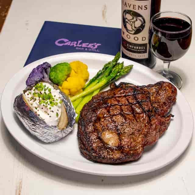 large ribeye steak and veggies