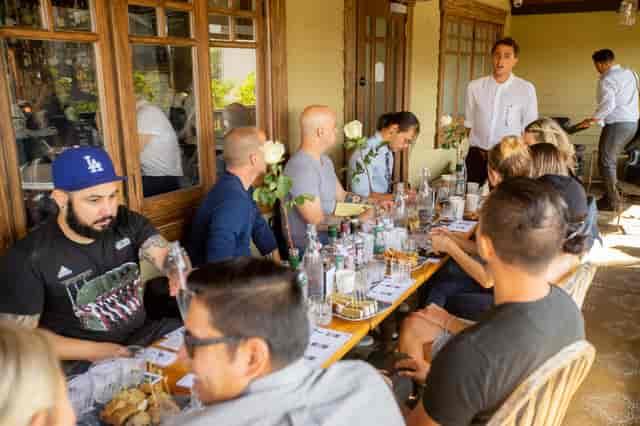 table of people tasting liquor