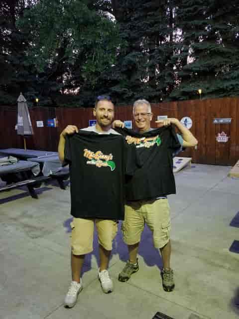 Men holding tshirts
