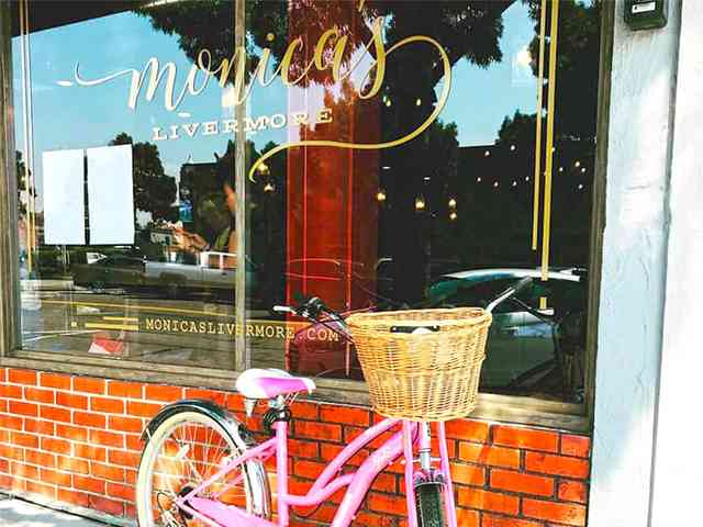 exterior of Monica's with bike