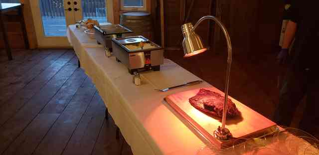 Table with brisket and catered spread