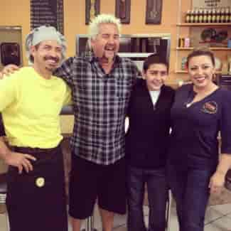 diners, drive-ins & dives star with perk eatery chef and owners