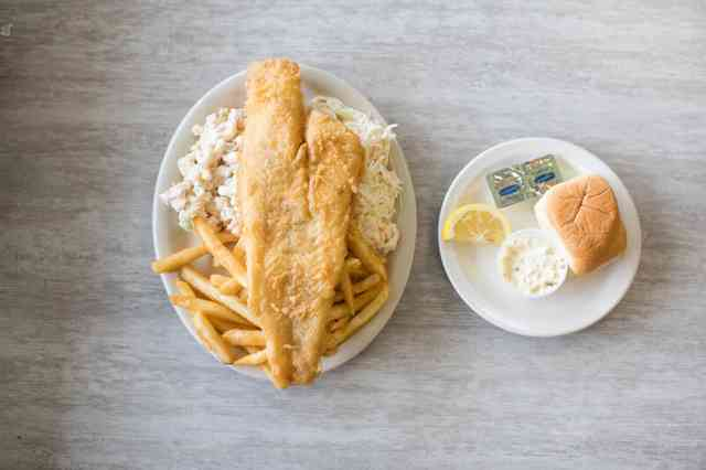 fish fry with fries, macaroni, and coleslaw
