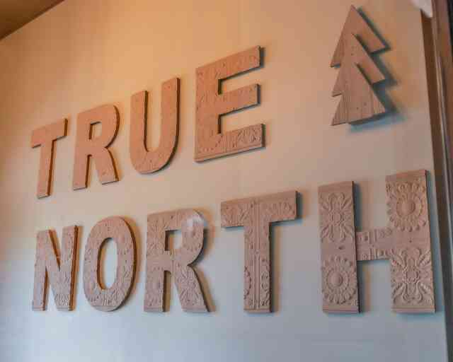 True North wall signage