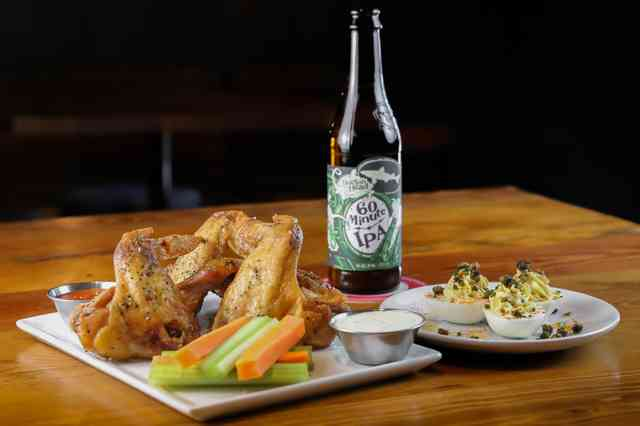 Wings and beer with various dipping sauces