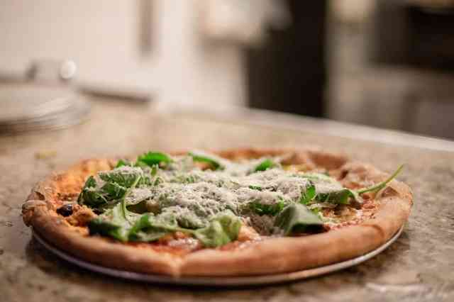 Pizza with fresh herbs and cheese