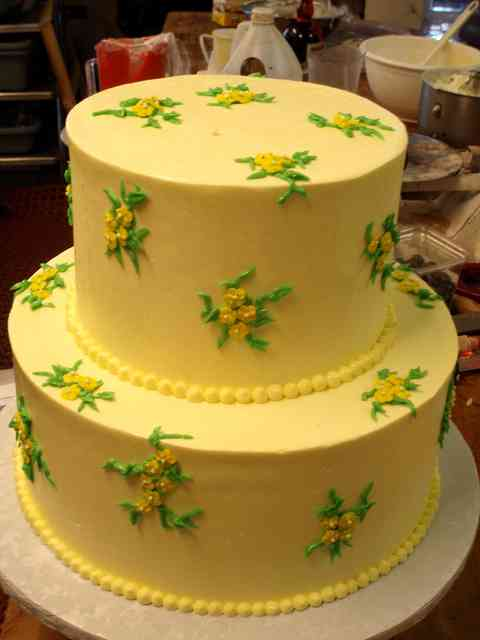 yellow cake with roses