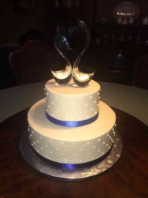 cake with purple ribbons