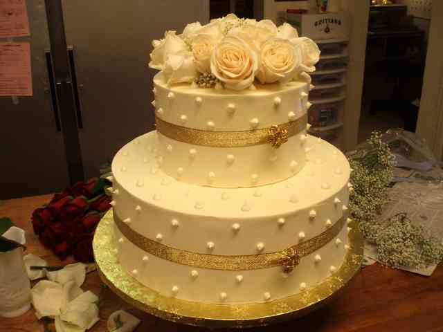 two tiered cake with ribbon