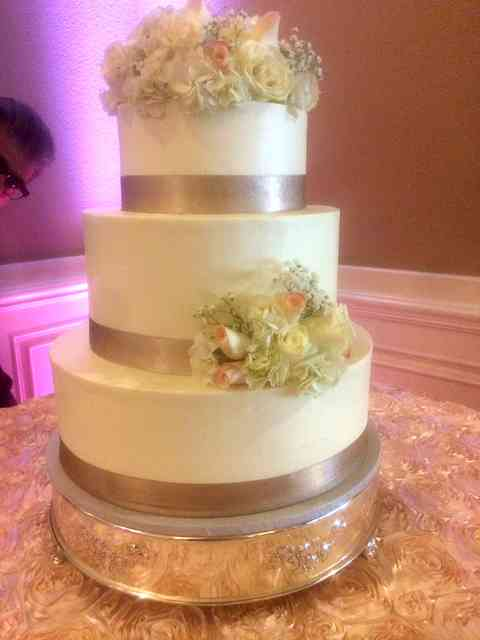 cake with gold ribbon