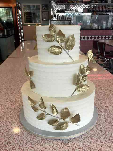 cake with gold vines