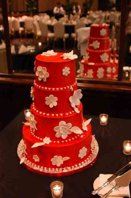 red cake and flowers