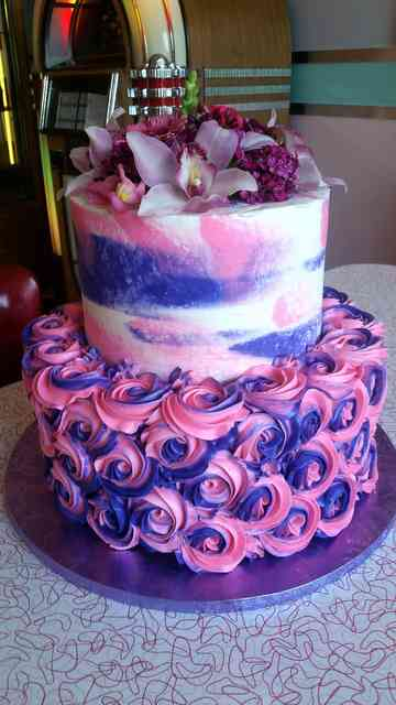 cake with pink and purple roses