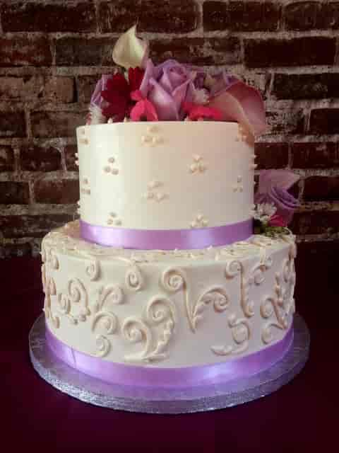 cake with purple ribbon