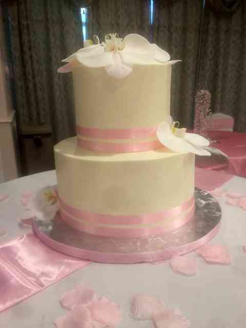 cake with pink ribbon