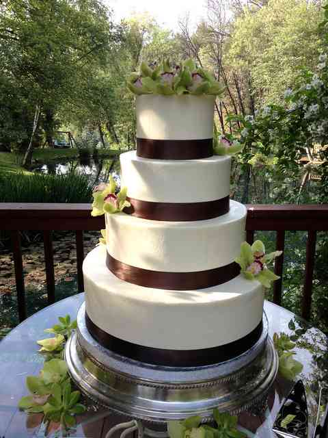 cake with brown ribbon