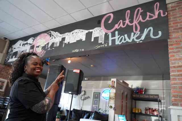 Work with us header image of owner point at Catfish Haven sign