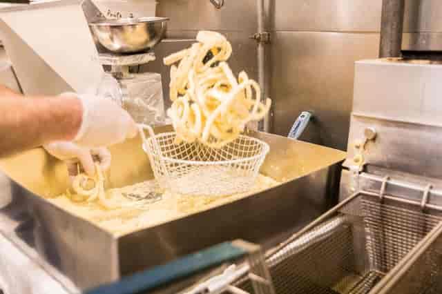 cook making calamari strips