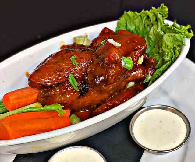 Chicken wings with dip, celery, and carrots