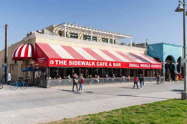 Outside awning that says The Sidewalk Cafe & Bar