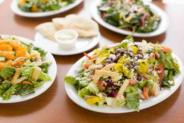 assorted salads and pita bread at chicken dijon in el segundo, redondo, and torrence CA