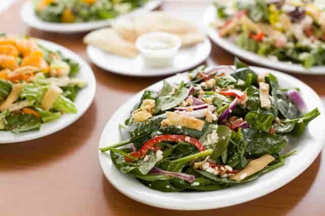assorted catered salads and pita bread at chicken dijon in el segunado and renondo beach, ca