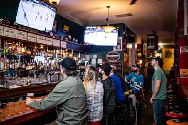 guys watching hockey at bar
