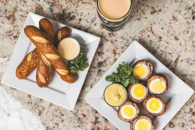 Appetizers - pretzels and scottish eggs with beer cheese