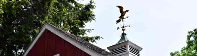 shot of top of a barn with weathervane