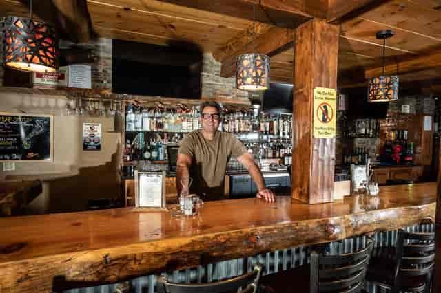 Man behind bar counter