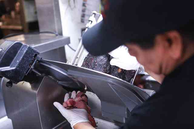staff shot slicing pastrami
