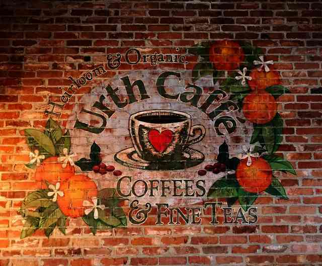 Urth Caffe Orange rustic logo painted on brick wall