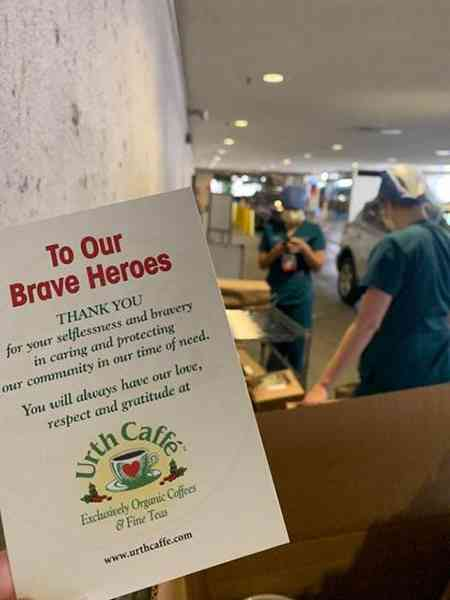 To Our Brave Heroes card with nurses and hospital entrance in background