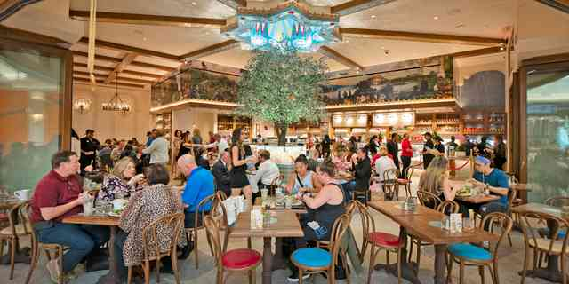 Urth Wynn Las Vegas interior with patrons at tables and order counter