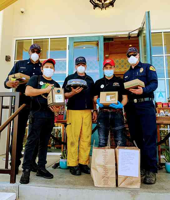3 Hawthorne Firemen, one with yellow pants, with two Urth employees on Urth South Bay entrance with Urth bags and lunch boxes