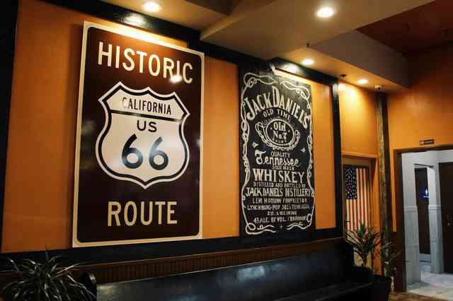 Route 66 sign and Jack Daniel's sign inside restaurant dining room