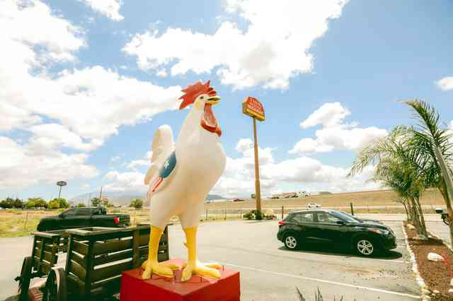 giant chicken statue in front of restaurant