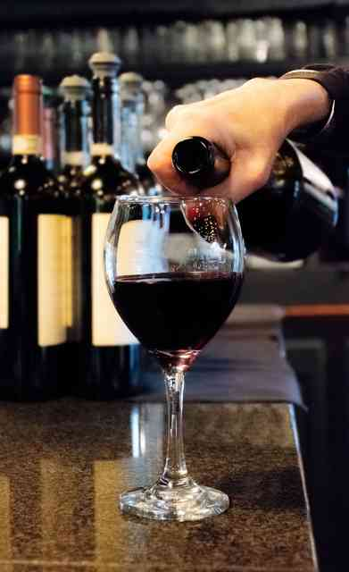 pouring a glass of wine