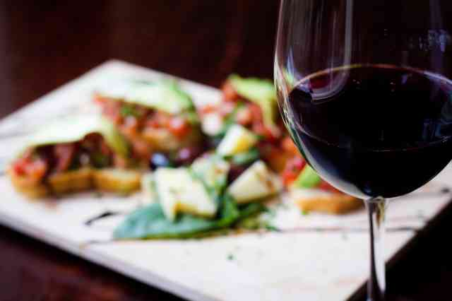 wine with salad in background