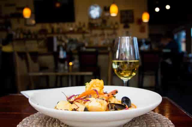 clam dish and wine