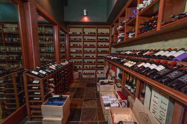 wine room with bottles long view